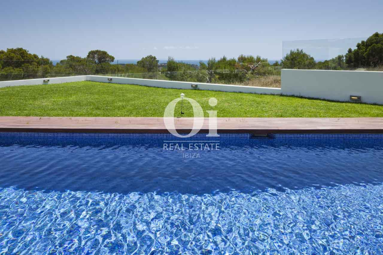 Piscine et jardin de maison en location de séjour à Es Cubells, Ibiza