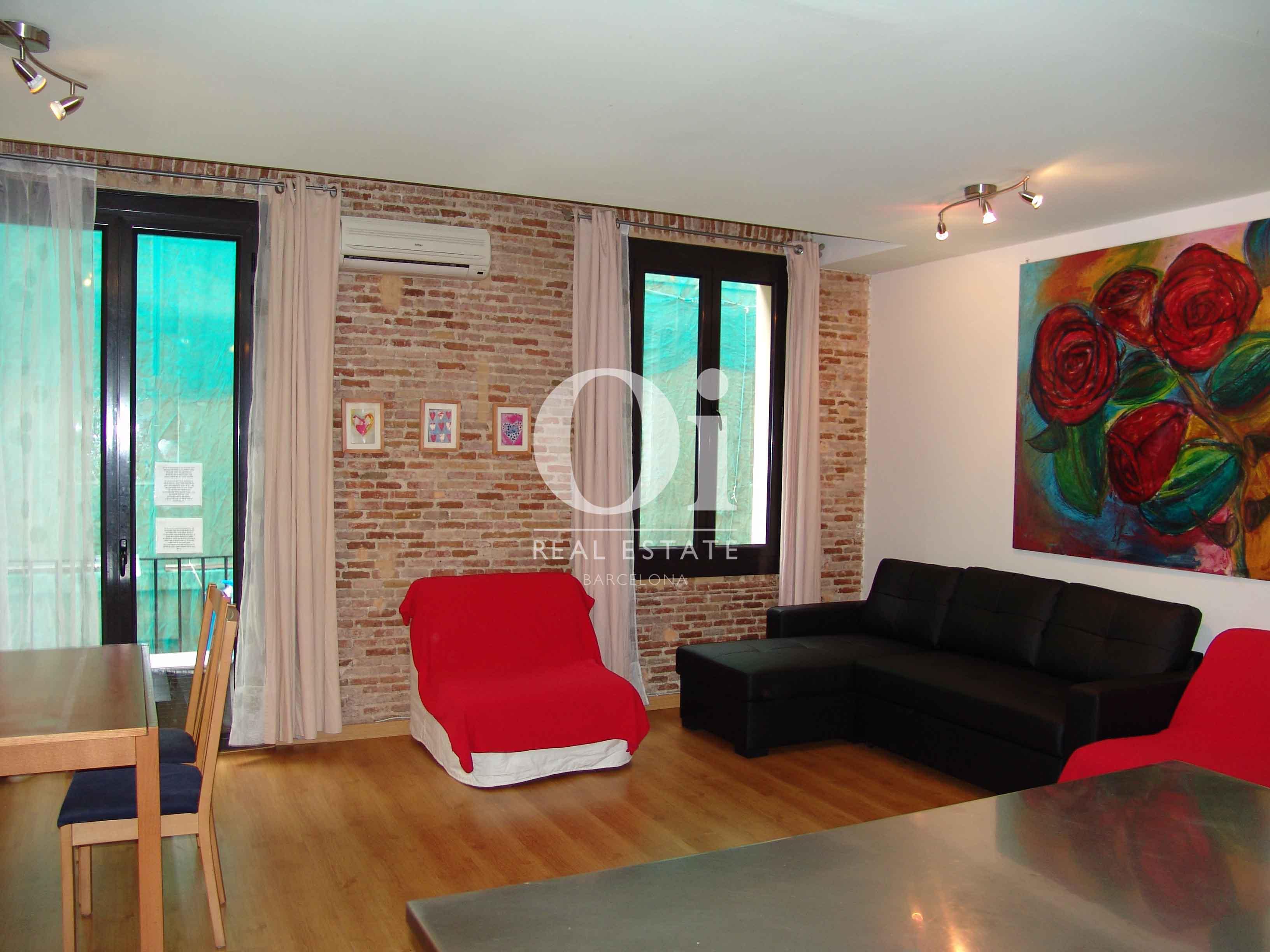 Sala de estar de magnifico apartamento en venta en Raval