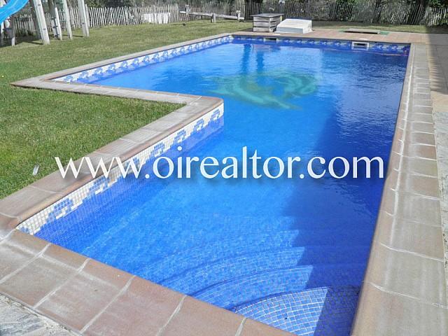 Huis te koop met twee onafhankelijke huizen in de urbanisatie Puigventós de Lloret de Mar