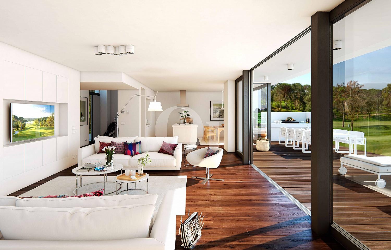 Wohn-Esszimmer mit grossen Fenstern und Zugang zu dem Garten