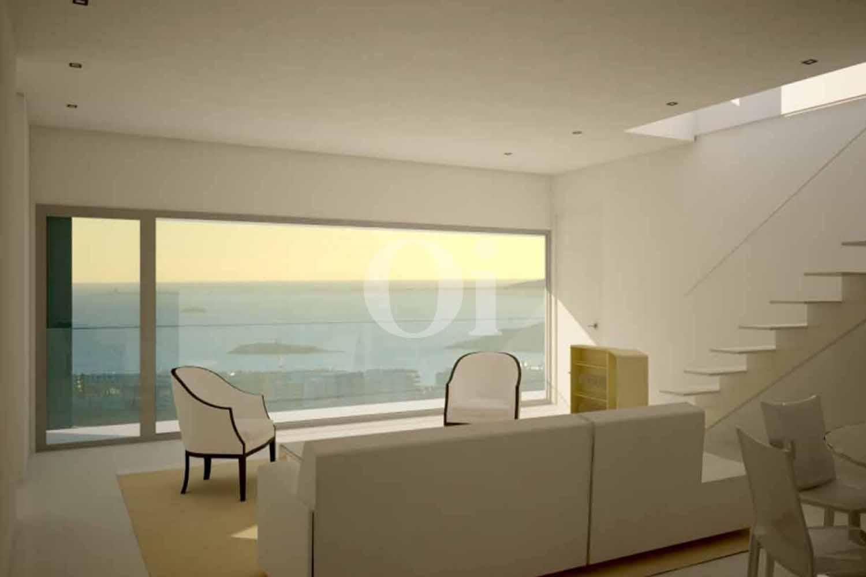 Потрясающая стильная гостиная с огромные окнами и незабываемыми видами на вилле на продажу на Ибице