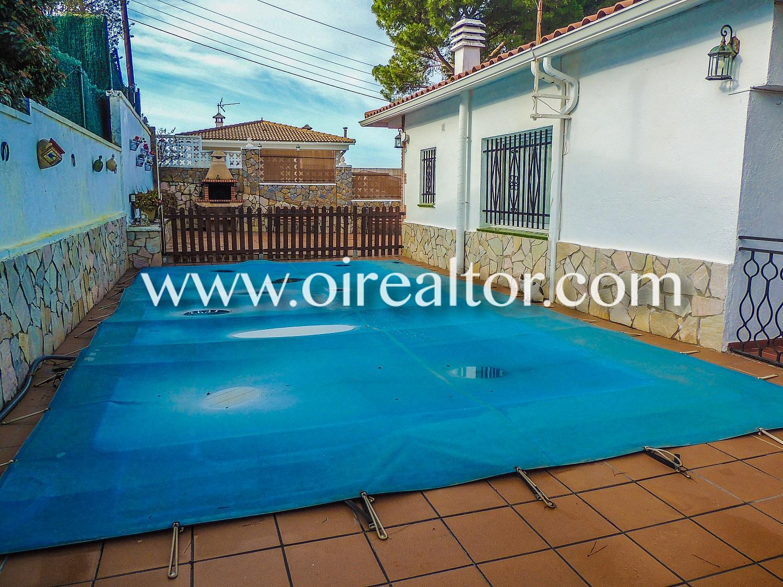 Солнечный дом с бассейном в Льорет-де-Мар