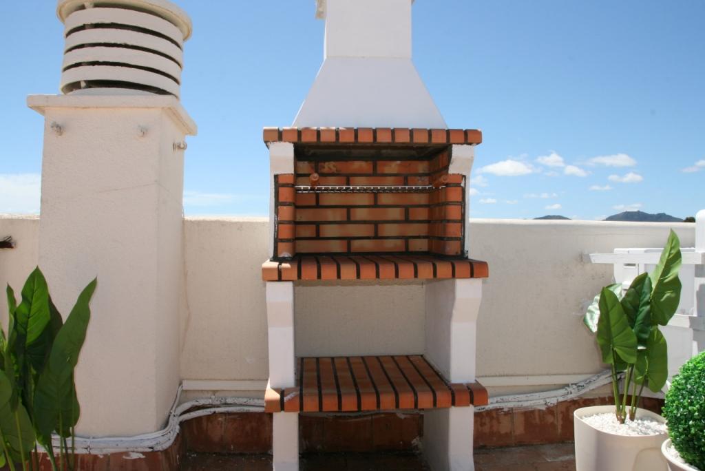 Zona de barbacoa de casa en venta en Mallorca con preciosas vistas