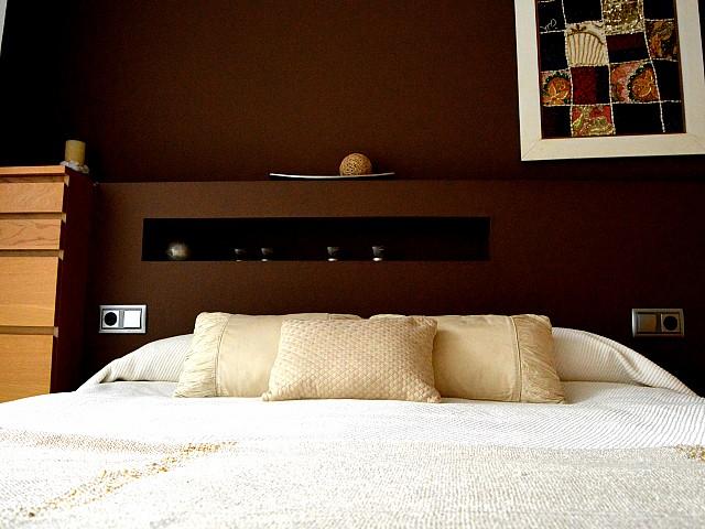 Кровать квартиры в аренду в Fort Pienc