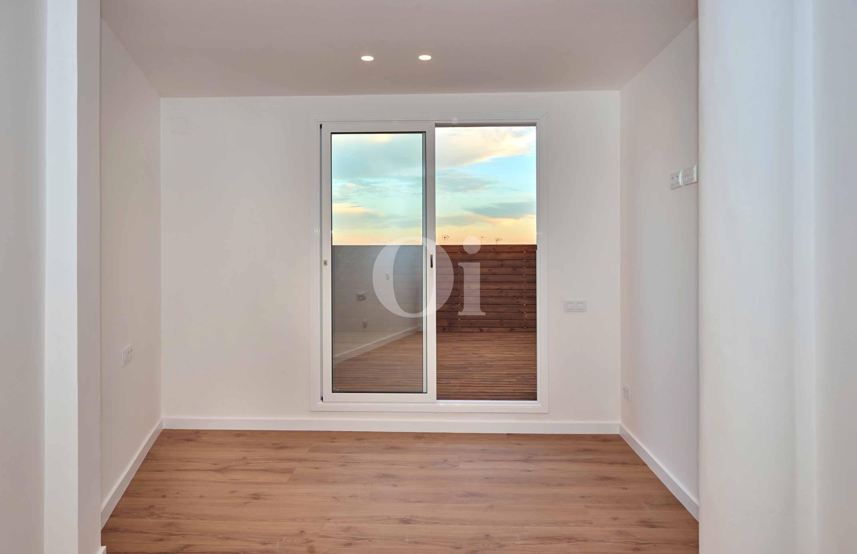 Acceso a la terraza desde uno de los dormitorios