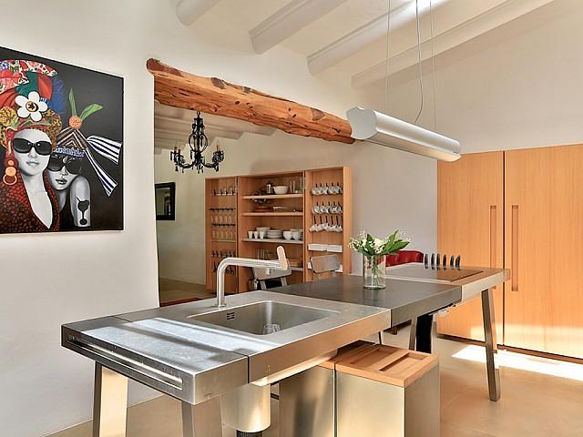 Cocina con isla central de cocción