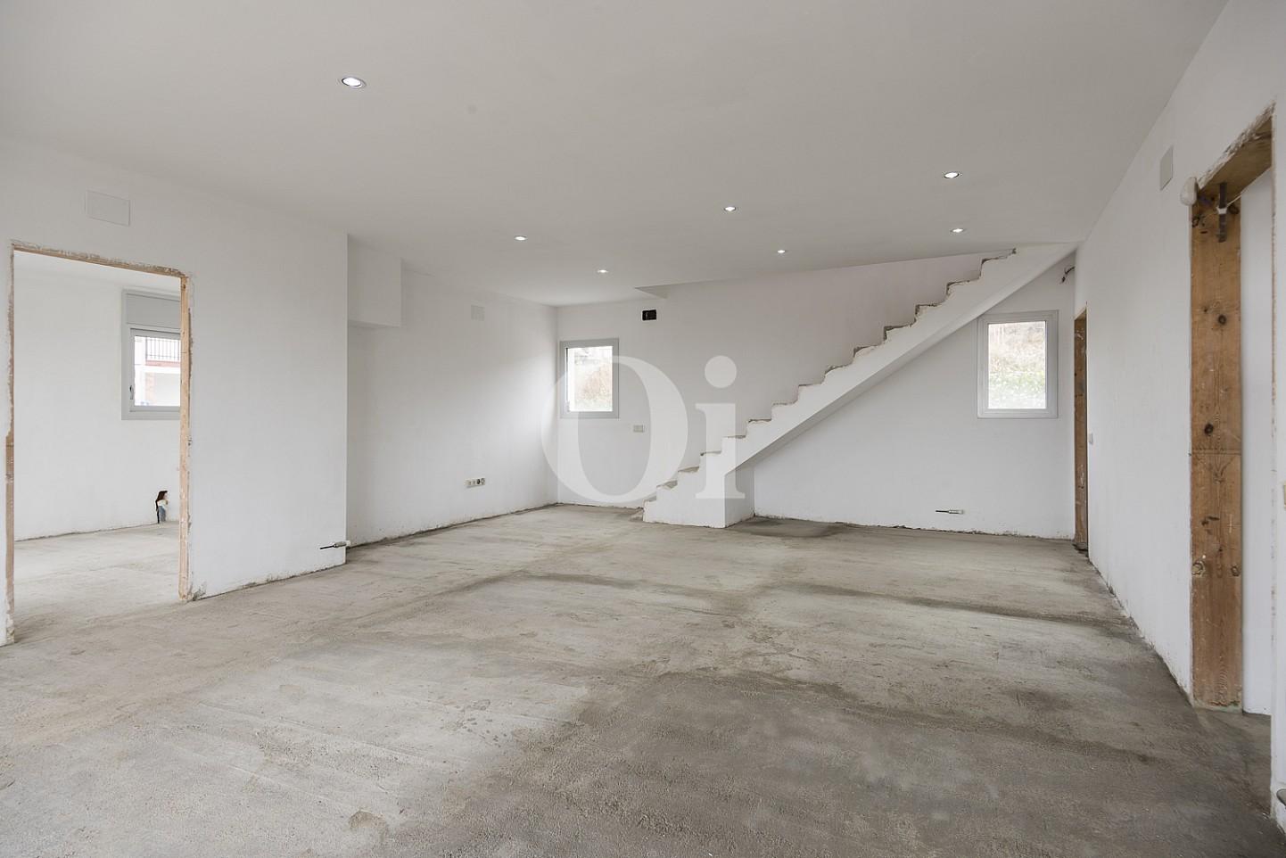 Zona de día con acceso al piso superior