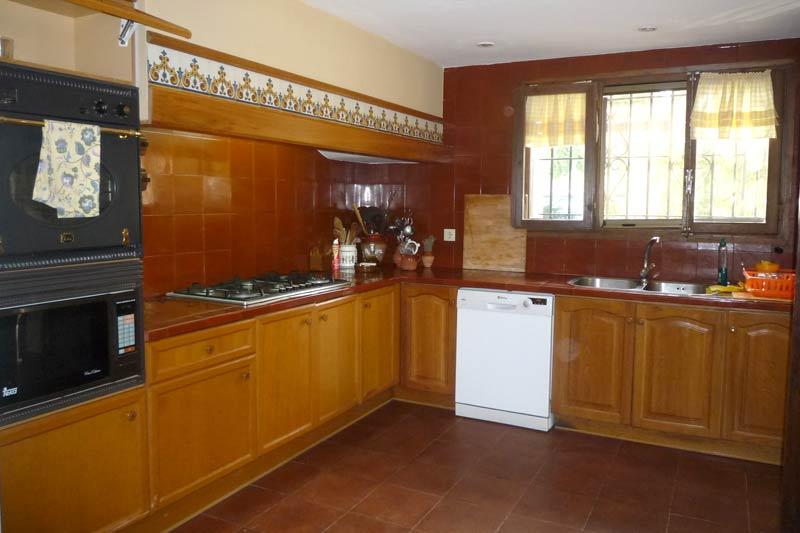 Отдельная кухня дома в Амелья де Мар