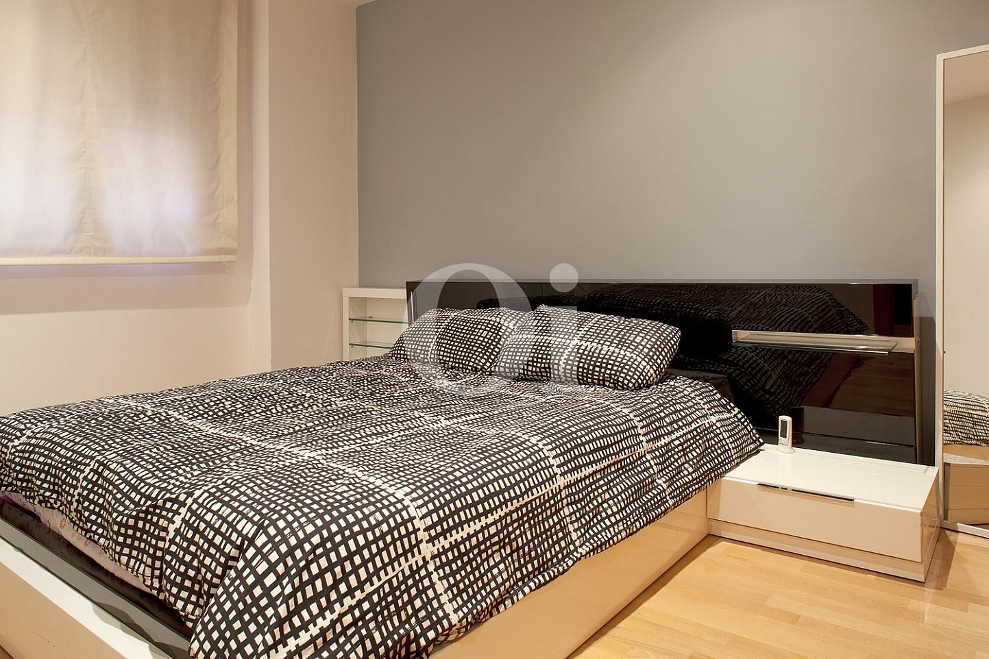 Уютная спальня квартиры в Саграда Фамилия